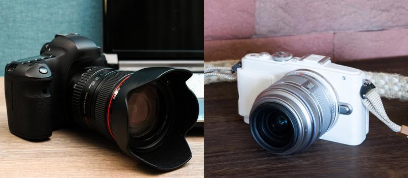 一眼レフカメラ(左)と、マイクロフォーサーズサイズのミラーレスカメラ(右)。